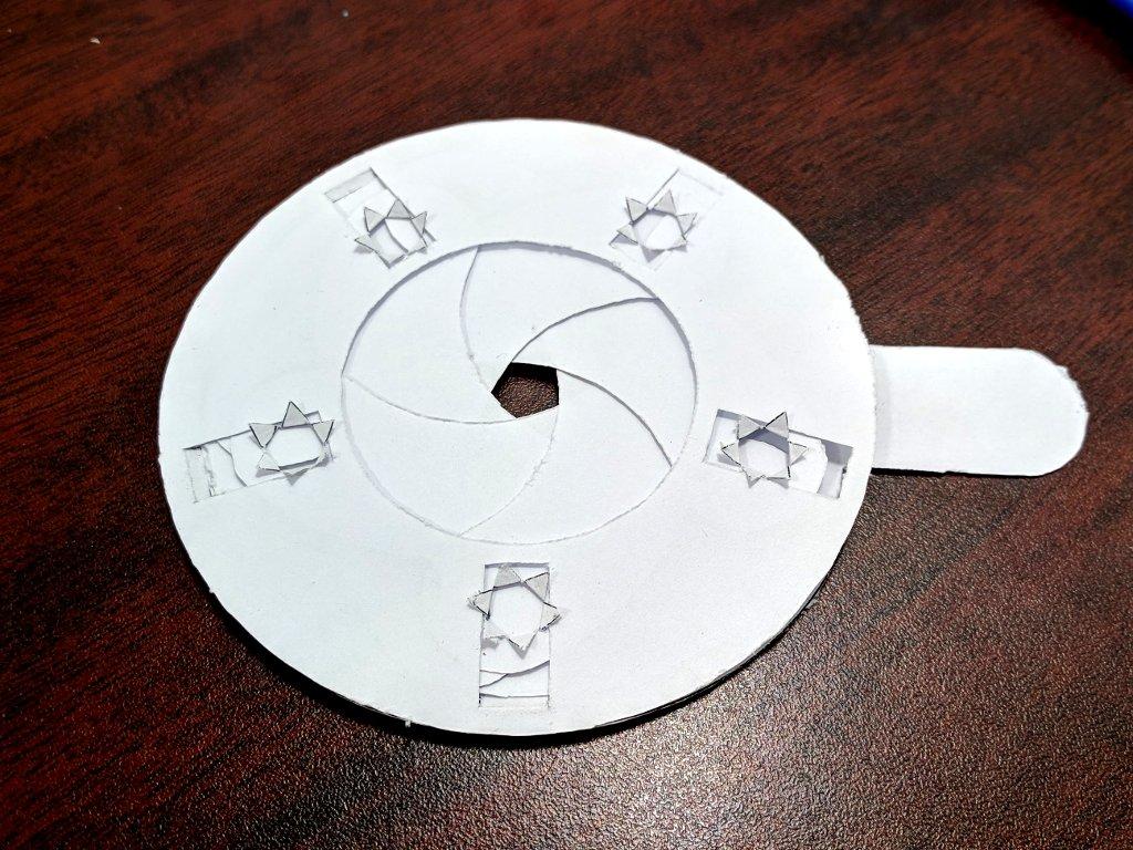 Paper mechanical iris glue